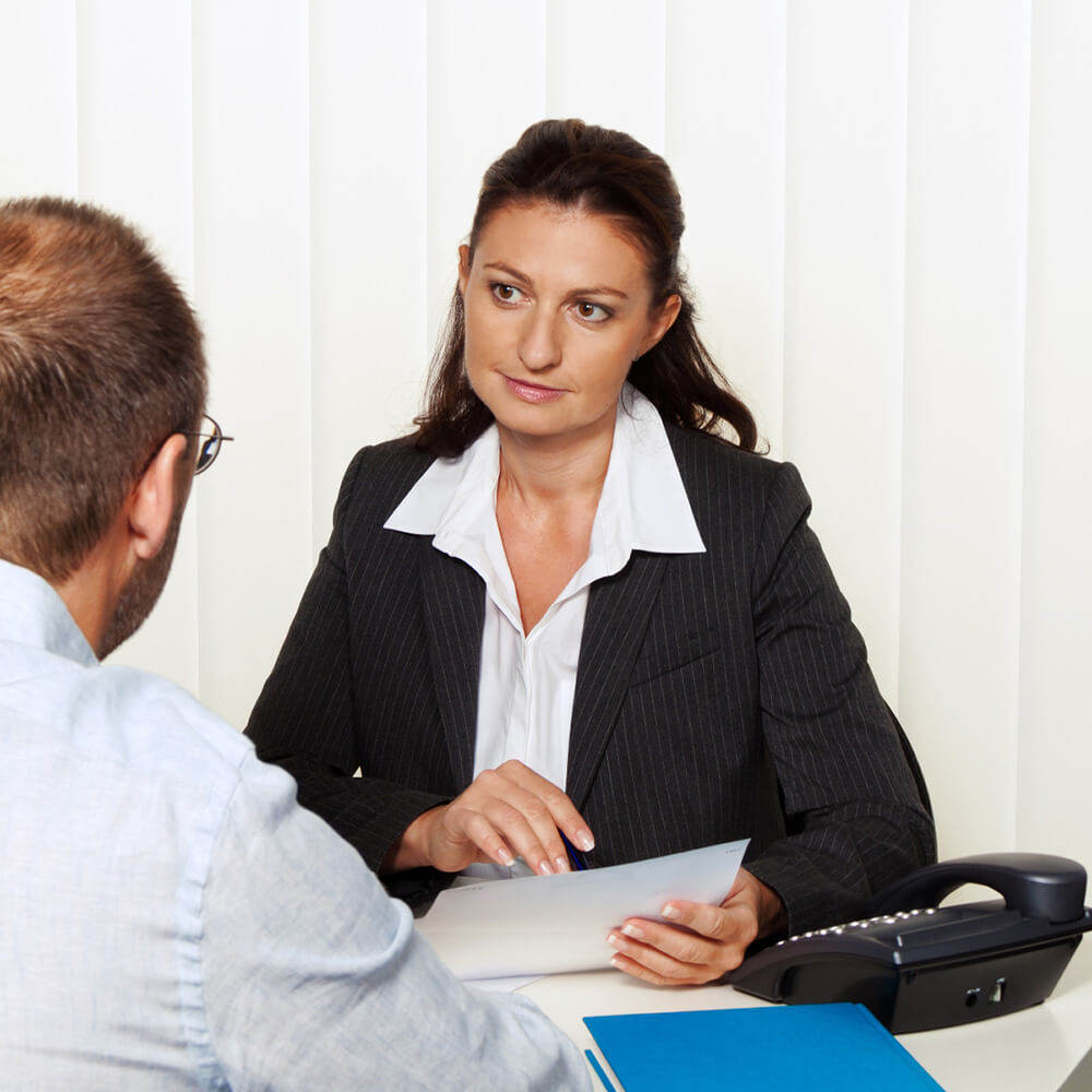 A man meeting with a female counselor