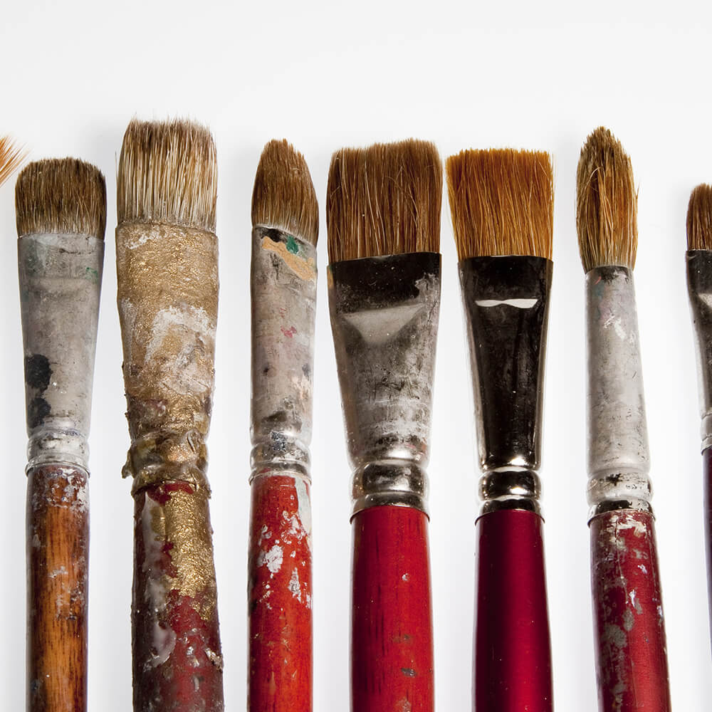 Six small used paint brushes