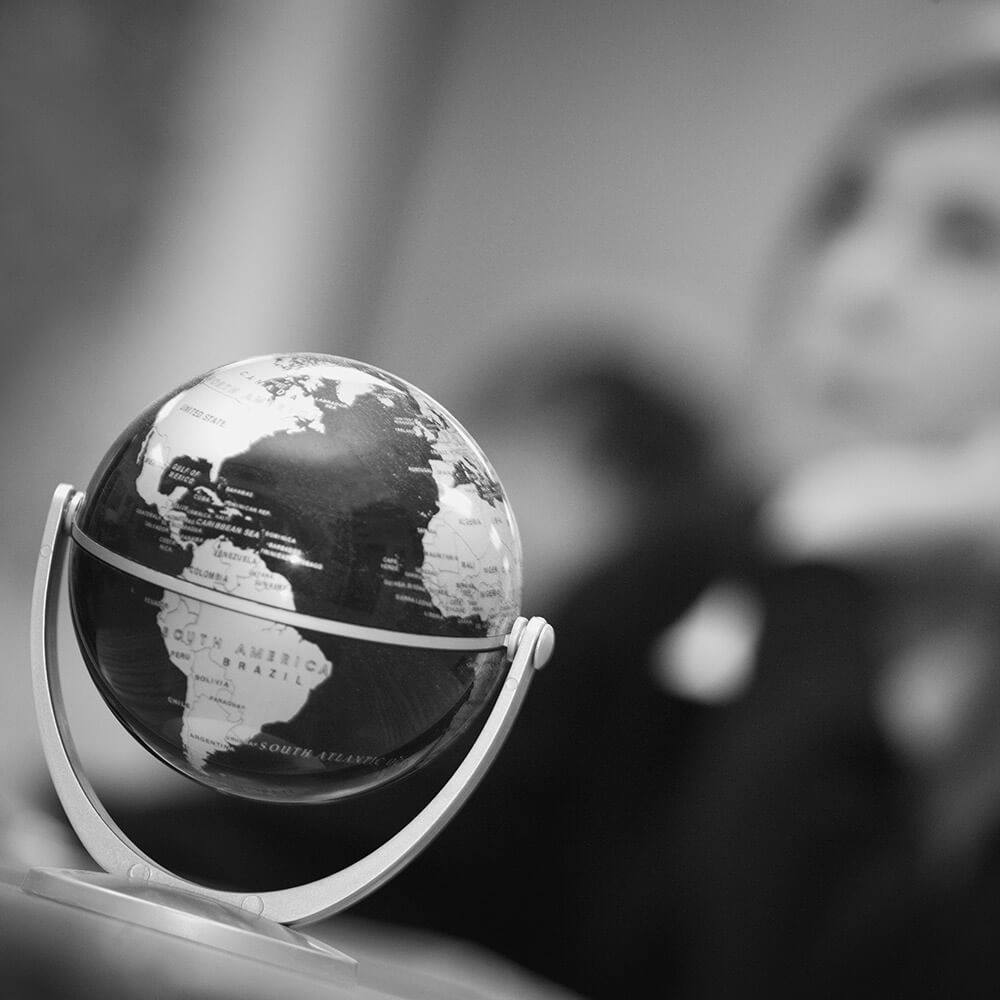 Black and white photo of a small globe