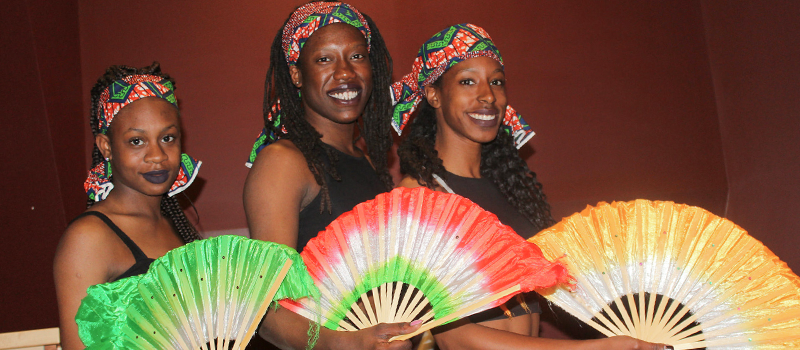 Three African women wearing traditonal style Jamaican clothing