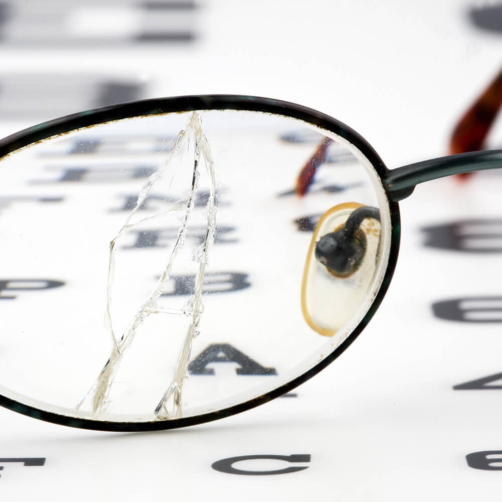 Broken glasses on an eye chart