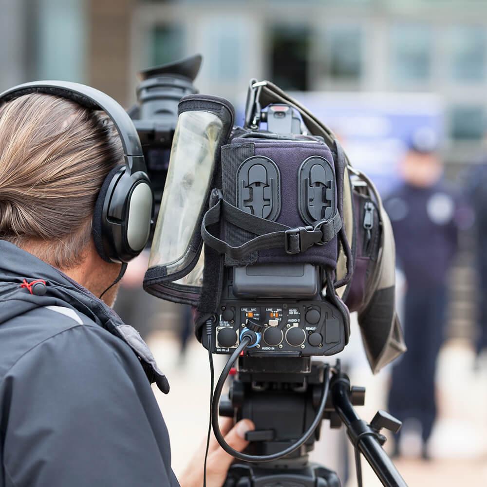 Camera man filming a scene