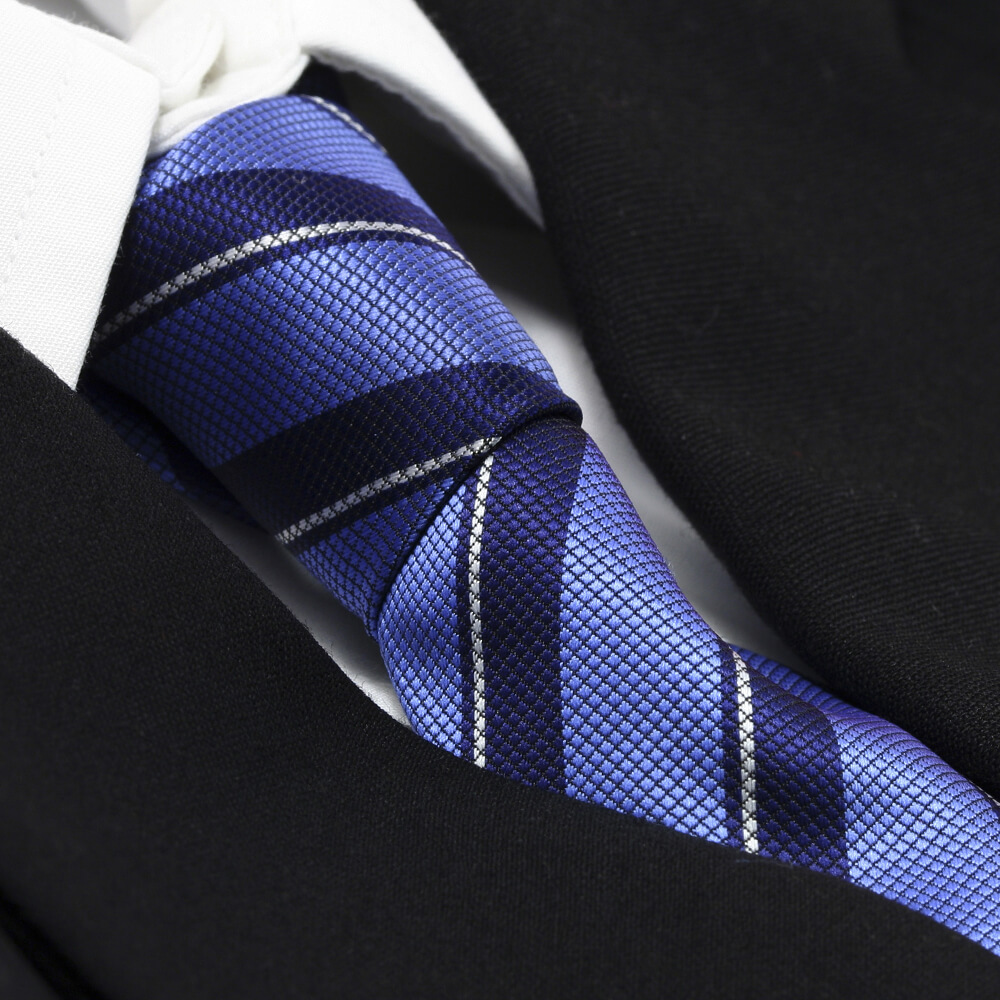 Closeup of a blue striped tie and black suit