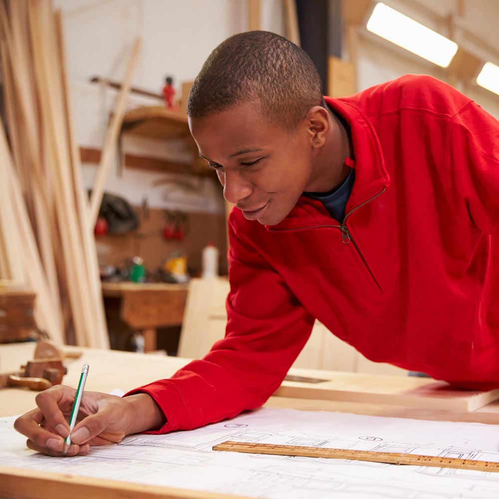 A young black male creating a construction layout