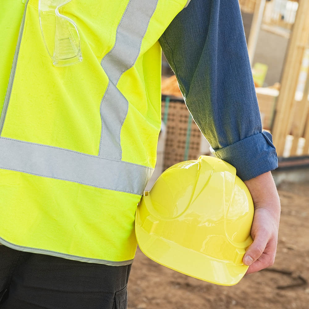 Contstruction worker holding a hard hat