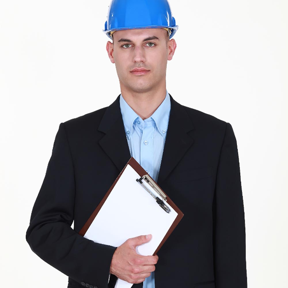 A man wearing a hard hat and holding a clipboard