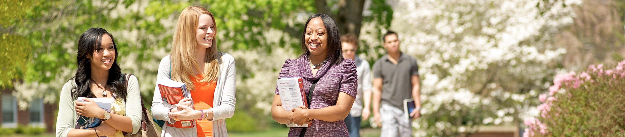 3 female students walking on the blackwood campus