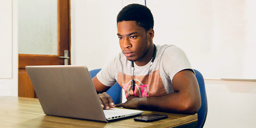 young African American man on a computer