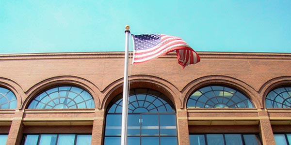 american flag in from of the Camden Campus