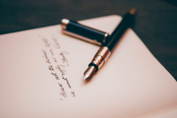 poetry on paper and a pen