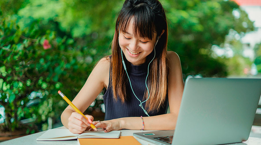 female student writing down transfer tips